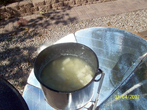 solar cooker boiling potatoes