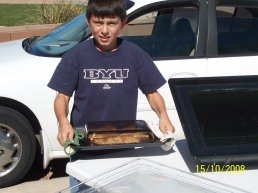 Joshua solar cooking at age 1