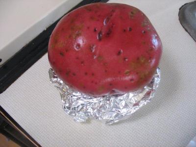 Potato on stand (hot dog taste  preventer)